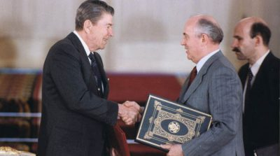 Gorbachev and Reagan shake hands after signing the INF Treaty